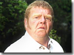Vernon Scripps played by Geoffrey Hughes.