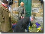 Claude Greengrass and George Ward lay wreaths at Dr. Ferrenby's door